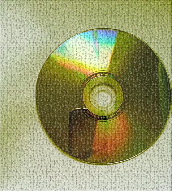 12527825-plyty--cd-kiedys-niezastapione-plyty-dzis-juz-stare-odeszly-do-historii-ujete-na-brazowym-tle.jpg (550x613)